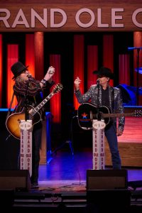 Big and Rich proclaim their favorite card is the 9 of hearts at the Grand ol' Oprey