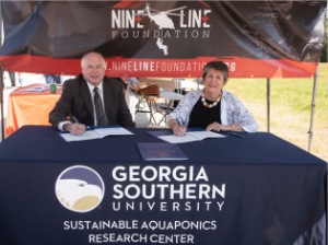Georgia Southern Provost and Vice President of Academic Affairs Carl L. Reiber Ph.D., and Nine Line Foundation President Megan Hostler signed a memorandum of understanding at the Armstrong Campus' Sustainable Aquaponics Research Center