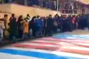 WATCH Iranian protestors refuse to trample US-Israel flags